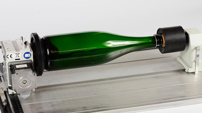 Laser engraving cylindrical objects, wine bottles