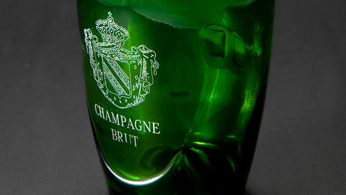 Engraving and personalization of glass bottles